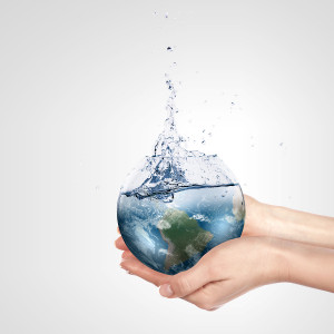 Globe in human hand against blue sky. Environmental protection c